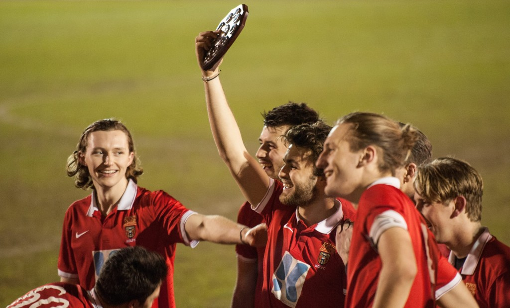 KCL Football club hold up Varsity trophy