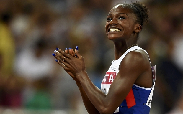 Dina Asher-Smith of Britain reacts after competing in the women's 200 metres final during the 15th IAAF World Championships at the National Stadium in Beijing, China August 28, 2015. REUTERS/Dylan Martinez