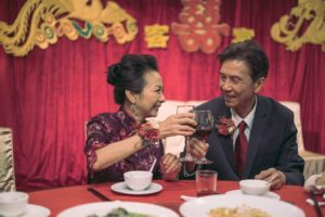 Still from Suk Suk (叔.叔) - Pak and Ching at their daughter's wedding banquet