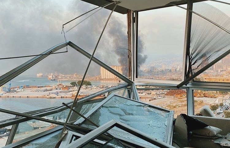 broken windows with smoke in the background, Beirut Blasts King's Students