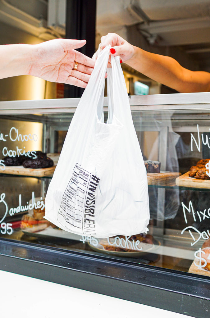 The #INVISIBLEBAG is handed across the counter after buying baked goods